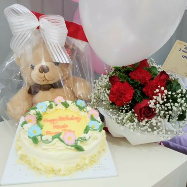 Cake, balloon, teddy, flowers