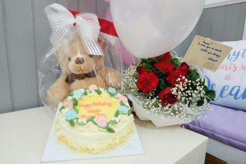 Cake, balloon, teddy, flowers